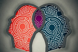 Complicated relationship as concept for group therapy or marriage counseling as two human heads made from maze merging together as icon of partnership solutions isolated gray background