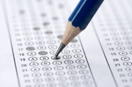 Multiple choice examination form with blue pencil